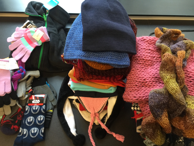 piles of scarves, hats, and mittens